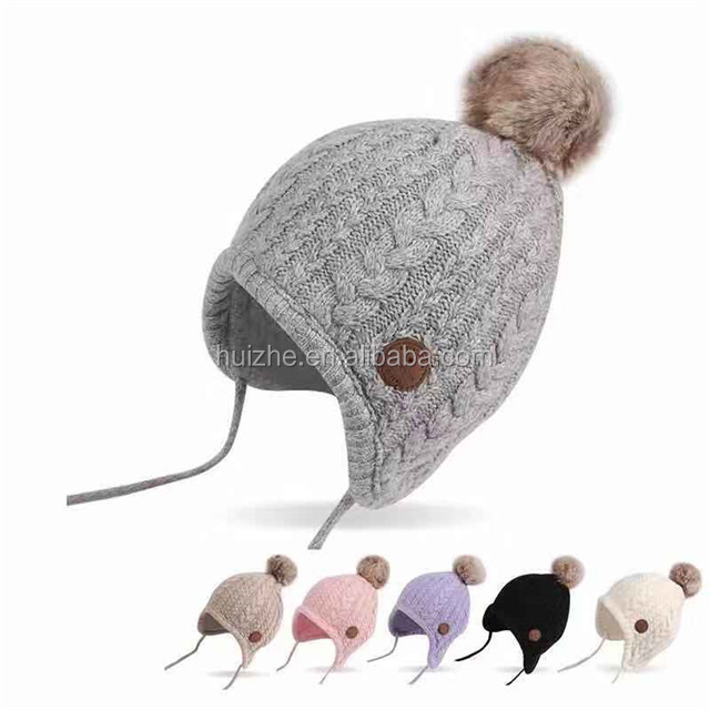 Wholesale Ages 2-8 baby hat Children Lace Up Winter Hats For Boys Girls Cotton Thick Warm Knitted Ears Beanie Fox Fur Pompom <strong>Cap</strong>