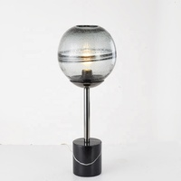 euprope classic style brushed chrome metal post black cylinder marble base gray glass egg ball table lamp