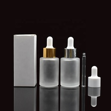 hot selling 30ml frosted <strong>flat</strong> shoulder glass cosmetic bottle with white paper boxes for essential oil