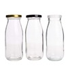 /product-detail/1000ml-1l-custom-round-small-glass-soy-milk-bottle-for-mineral-water-62097845579.html