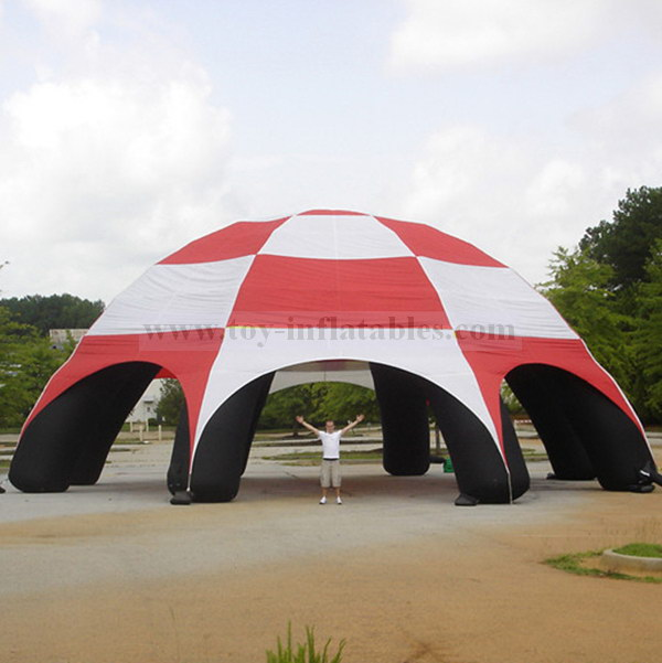 Large inflatable tent with leg