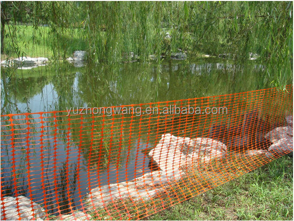 Orange plastic temporary fencing mesh