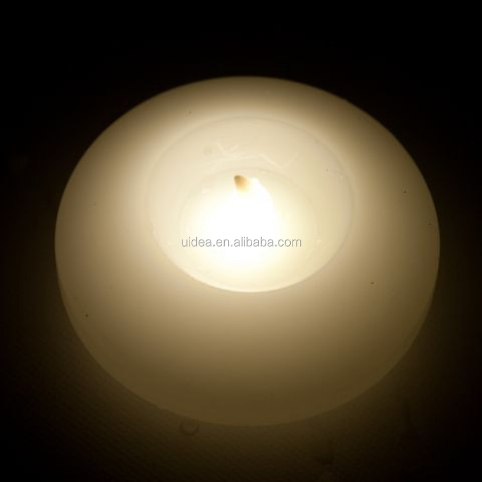 Battery Opearted Water Floating Real wax LED Flameless candle with warm white light for vase