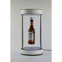 acrylic 360 degree rotating and floating display stand for bottle, ok for weight difference of 200gs