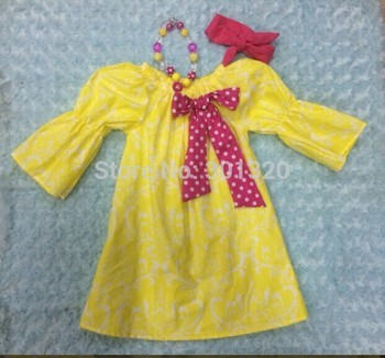 baby girls dress with matching hair bows and chunky necklace set