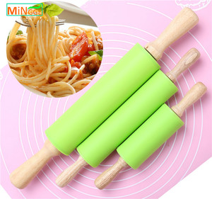 promotion FDA/LFGB Utility Comfortable Antiskid New Design mini Wooden Handle Silicone noodle Rolling Pin