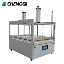 Vacuum compression sealing packaging machine