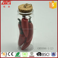Small glass wish bottle with artifical pepper inside