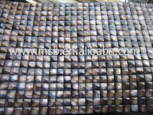 Dyed brown 3D convex seamless shell tile on mesh