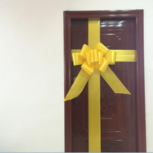 Large yellow flat ribbon bows for Christmas door decoration