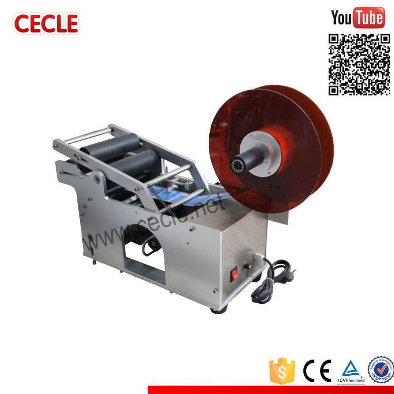 Portable manual adhesive labeling machines for tubes