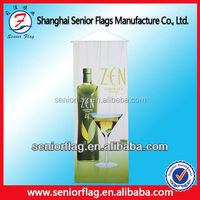 Hanging flags with rope and wooden pole for hanging on wall, hanging banner
