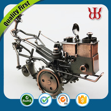 Tractor shaped metal handicraft