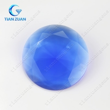 Synthetic blue or pink round diamond cut glass gems