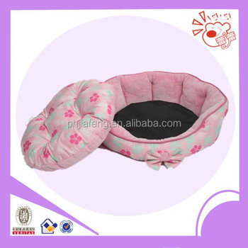 Pink dog bed with flower