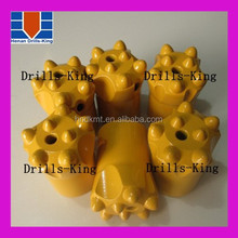 Tungsten carbide nail drill bits tapered button bits