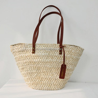 Hot selling wholesale handmade woven corn husk rope straw beach bags with leather handle