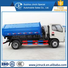 Manual transmission type and new condition affordable mini type hook lift roll arm garbage truck sale in China
