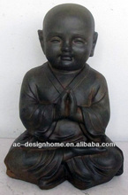 FIBRE CLAY SEATING PRAYING MONK STATUE
