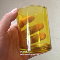 yellow color glass candle holder