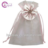 pink organza drawstrings pouches with rosette decoration