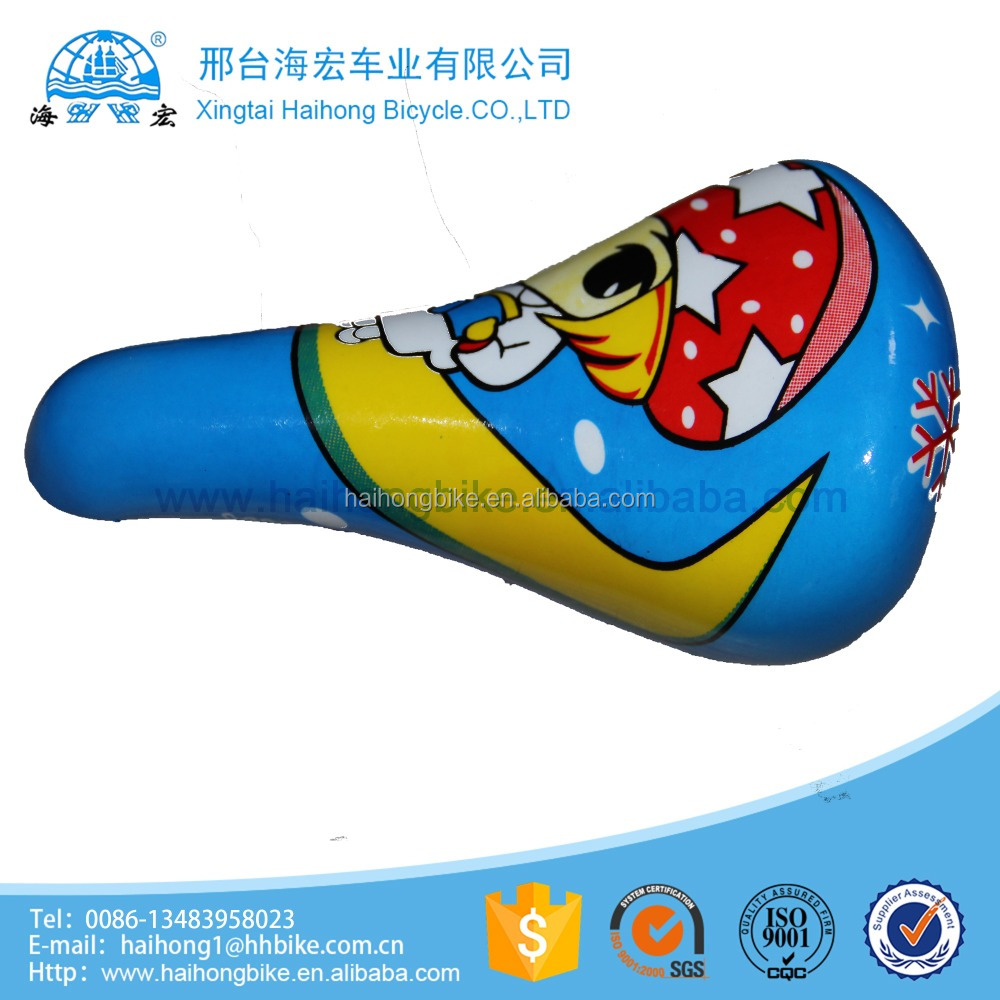 Orange cartoon drawing plastic baby riding bicycle saddle