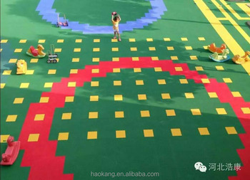 Plastic interlocking floor tile used for outdoor playground