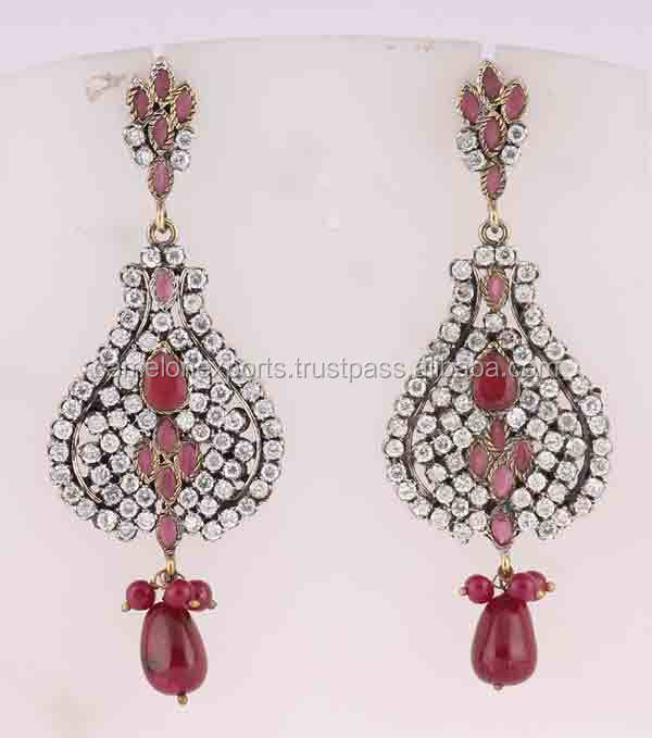 Indian party wear wedding dangle earrings CZ studded fine jewelry. Indian manufacturers fashion jewelry. Brass metal.