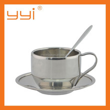 stainless steel coffee cup with spoon and saucer