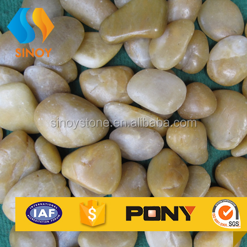 Natural yellow river stone pebbles