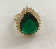 Yellow gold emerald RING in drop shaped with diamond surface