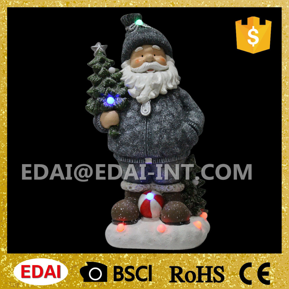 Grey painting christmas standing santa claus statue holding christmas tree