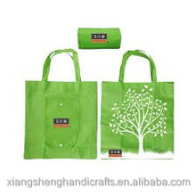 Non Woven Circle Tote Bag has large round carry handle and snap button closure and inside valuables pocket