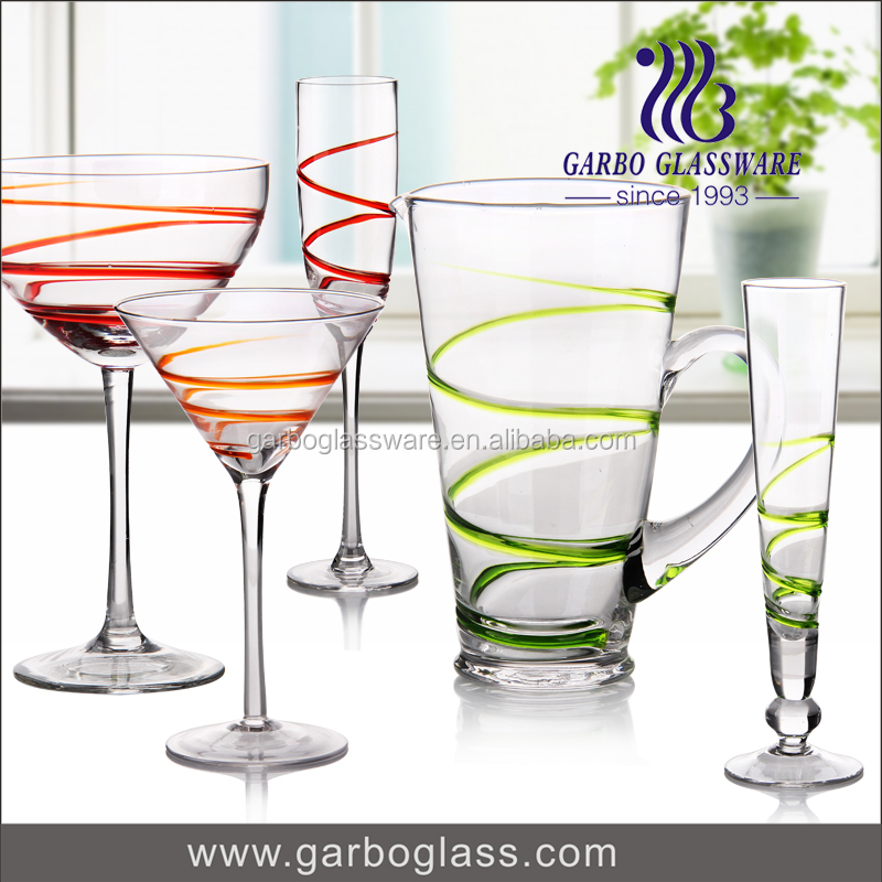 Colorful champagne flute drinking glass cup and glass jug cocktail wine glass