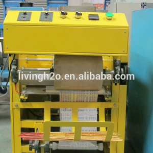 China small plastic water bag filling packing machine