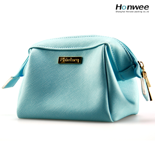 Metal carved custom logo fashion promotional light blue pu cosmetic bag makeup bag