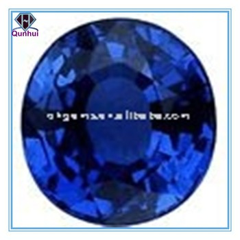 luminous dark blue oval shaped gemstone