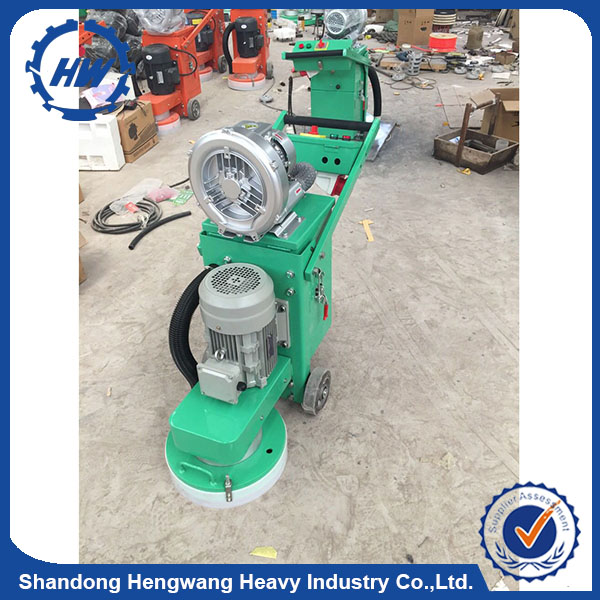 Handheld Concrete floor grinder for polishing with industrial vacuum cleaner