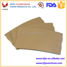 Brown coffee cup sleeve made of kraft paper with corrugated paper