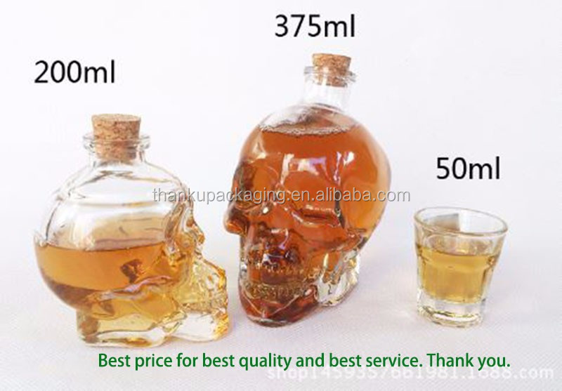 Hot sale skull shape glass bottle for gin whiskey brandy