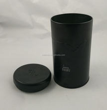 Black round metal tea tin with insert lid