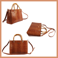 Stylish Designed Bamboo Handle Bag Made Of Real Leather