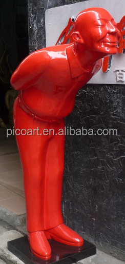 outdoor attractive decoration red color bowing man welcome sculpture