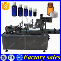 Low price 30ml essential oil filler,filling plugging and capping machine