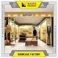 Famous brand men 's clothes shop ,fashion clothes shop decoration design ,metal hanging clothes display stands