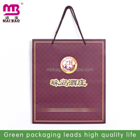 Boutique CMYK printing neat and tidy customized paper bags for promotion