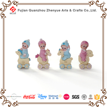 Handmade resin baby family ornaments Riding wooden horse baby resin figurine ornaments