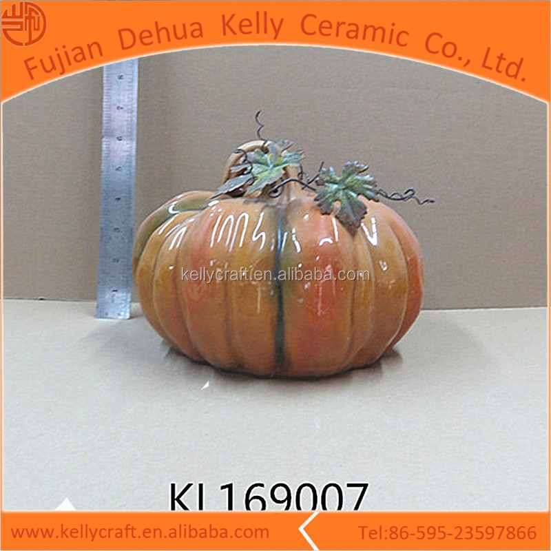 Color glazed finishing ceramic pumpkin with metal leaf