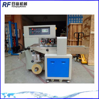 Automatic candy pillow type packaging machine