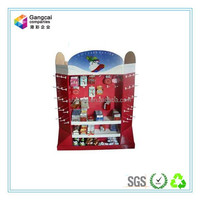 red paper counter top display with hooks for small goods